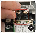 Wireless card, photo 2: pulling up on the connectors.