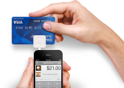 The Square card reader attaches to an iPhone or iPad.