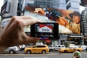 New AR iPhone App Replaces Ads with Art