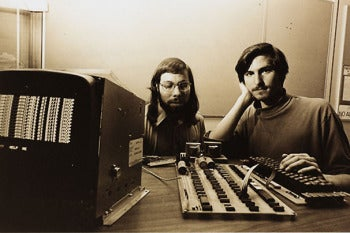 Steve Jobs, right, and Steve Wozniak in 1976 with the first Apple computer.