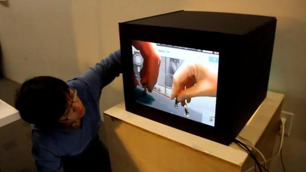Jayne Vidheecharoen interacts with toy people in interactive world, Credit: Jayne Vidheecharoen