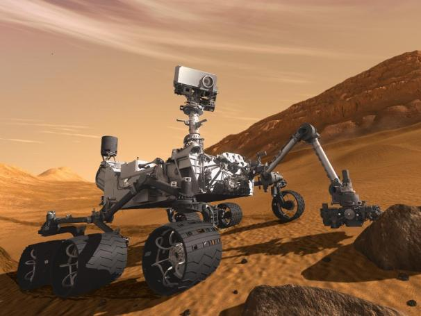 Artist concept of NASA's MSL Curiosity rover investigating Mars; Credit: NASA