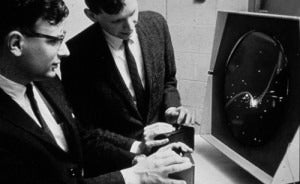 Two men playing spacewar on a PDP-1, circa 1962