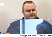 Kim Dotcom stands before a New Zealand court facing on Friday. Image is from a screen capture of 3News.co.nz