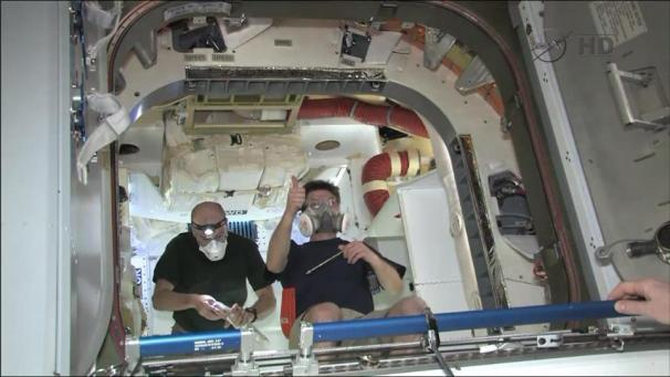 Astronauts inside the Dragon on the ISS. [Credit: SpaceX]