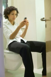 On the phone on the toilet
