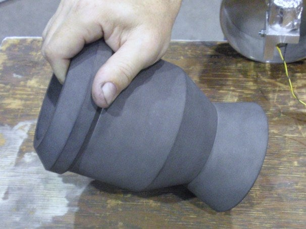 A graphite rocket engine nozzle made by Team Phoenicia