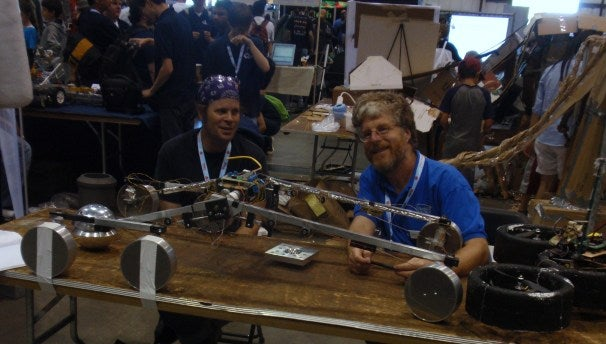 Team Phoencia's Maker Faire Booth: Left: James Erd (machinist), Right: Steve Berl (real time programmer)