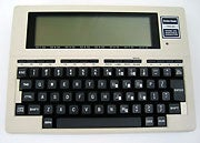 Tandy computers, including the TRS-80 Model 100 shown here, benefited from the accessible Tandy Deskmate GUI.