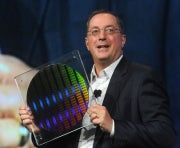 Intel CEO Paul Otellini holds up a wafer of 22nm SRAM chips.