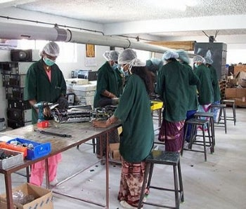 Workers at this e-waste processing center in Bangalore, India, have more protection than others.