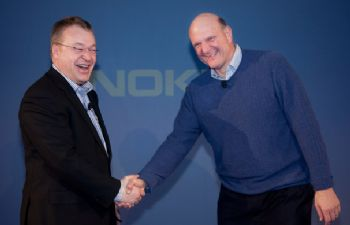 Old friends reunited. Ballmer and Elop shake hands to make the Nokia-Microsoft alliance official.