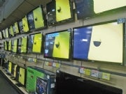 A wall of HDTVs at Best Buy